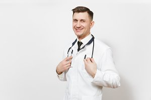 Smiling confident experienced handsome young doctor man isolated on white background. Male doctor in medical uniform, stethoscope looking camera. Healthcare personnel, health, medicine concept.