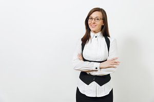 Beautiful caucasian young smiling brown-hair business woman in black suit, white shirt and glasses holding hands crossed isolated on white background. Manager or worker. Copy space for advertisement.