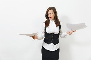 Shocked perplexed stress angry young brown-hair business woman in black suit, white shirt and glasses with documents isolated on white background. Manager or worker. Copy space for advertisement.
