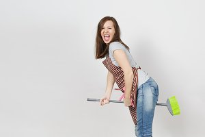 Young fun crazy dizzy loony wild screaming housewife with tousled hair in striped apron, squeegee in pocket isolated on white background. Mad witch woman flying on broom. Copy space for advertisement.