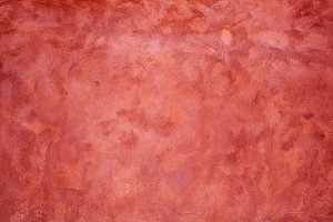 red stucco wall texture