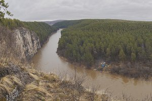 Panorama of fascinating view overlooking the mountain river and dense forest - Russian Ural