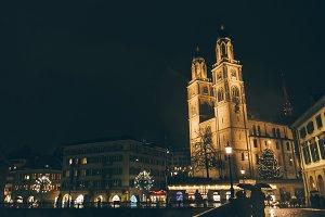 View of Grossmunster Church in Zurich old town, on the river side of Limmat, Zurich, Switzerland