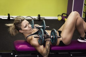 attractive woman doing weightlifting