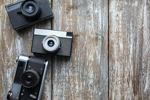 Old photo cameras wooden texture