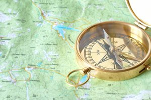 Ancient golden compass on the map