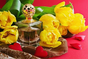 bottle of perfume and tulips