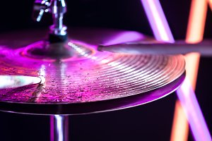 Hi-hat close-up of plates with drumsticks