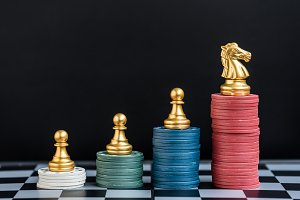 chess pieces on stack of casino chip