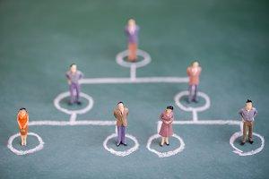 miniature people in circle chalk