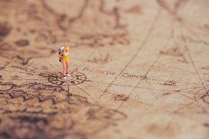 miniature traveler on vintage world