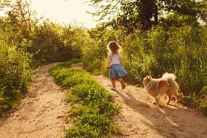 Little girl walking and Spitz