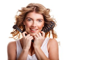 Girl holding makeup brush and comb