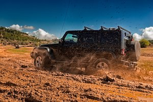 All-terrain vehicle crossing a mud a