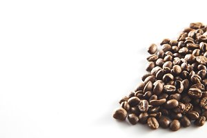 Roasted coffee beans on the table.