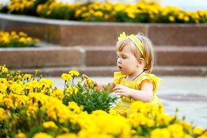 Girl near a flower bed