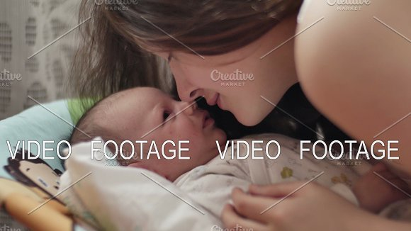 beautiful young mother smile and kiss her child