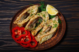 Fried fish in clay plate