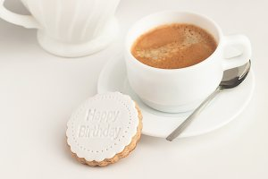 Coffee cup and fondant cookie.