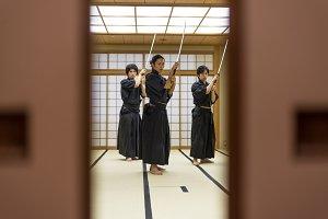 Samurai practicing Kendo in a dojo