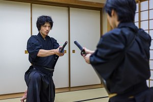 Samurai practicing Kendo in a dojo
