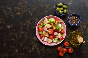 Fattoush Arabian salad. Brown background, top view, space for text.