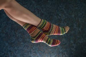 Woman legs in wool knitted socks