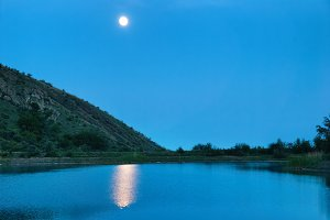 Landscape with moon above the lake