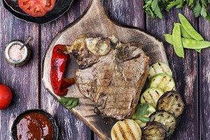 Grilled T-bone steak seasoned with s