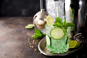 Saint Patrick's Day green drink cocktail with lime and mint