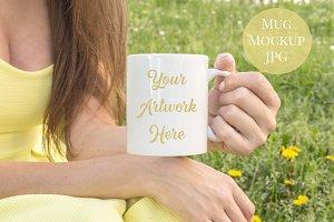 Woman holding mug- yellow dress
