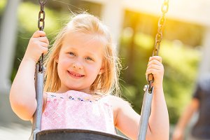 Young Girl Having Fun On The Swings