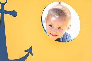 Boy Having Fun At The Playground