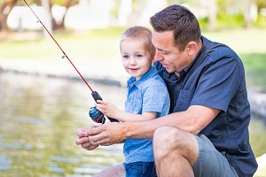 Father and Son Fishing at Park Pond