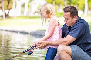 Father and Daughter Fishing at Pond