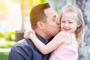 Father & Daughter Having Fun at Park