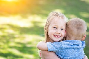 Boy and Girl Hugging At The Park
