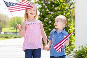 Boy & Girl Waving American Flags