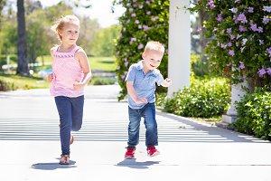 Sister & Brother Having Fun Running