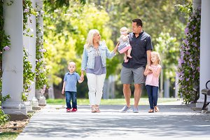 Young Caucasian Family Taking A Walk