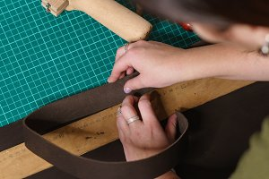 Tanner measures leather blank