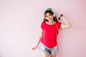 Young Woman Enjoying with Music