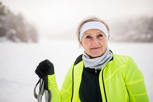 Portrait of a senior woman skiing.