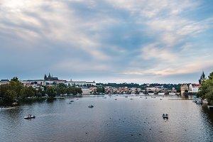 Cityscape of Prague and Vltava river at sunset
