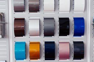 Many car color swatch palette selection in automotive car showroom