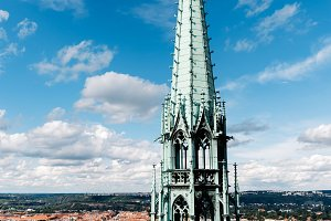 Outdoor view of towers of St. Vitus Cathedral of Prague against