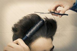 hands with scissors cutting hair, ha