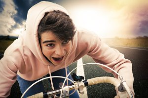 young man on bicycle doing sport