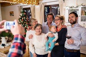 Beautiful big family celebrating Christmat together being photog