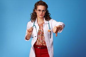 paediatrician woman thumbs down on blue